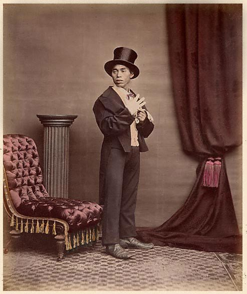 raimund_von_stillfried_-_japanese_gentleman_in_western_garb